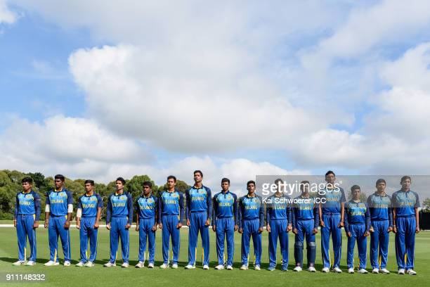 Captain Kamindu Mendis of Sri Lanka and his team mates line up for their national anthem prior to the ICC U19 Cricket World Cup Plate Final match...