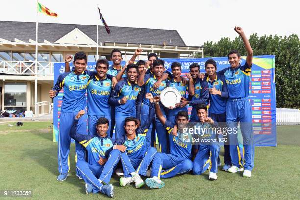 Captain Kamindu Mendis of Sri Lanka and his team mates pose with the trophy after their win in the ICC U19 Cricket World Cup Plate Final match...