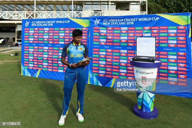 Captain Kamindu Mendis of Sri Lanka holds the trophy after their win in the ICC U19 Cricket World Cup Plate Final match between Sri Lanka and the...