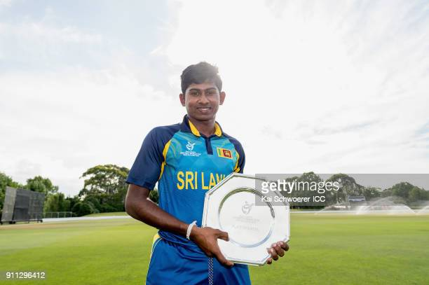 Captain Kamindu Mendis of Sri Lanka poses with the trophy after their win in the ICC U19 Cricket World Cup Plate Final match between Sri Lanka and...