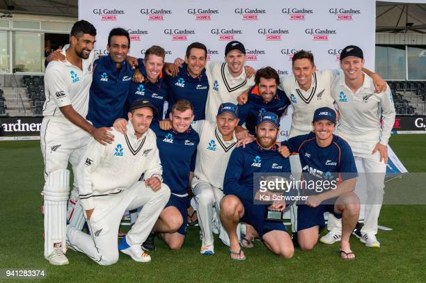 Captain Kane Williamson of New Zealand and his team mates celebrate their series win with the trophy during day five of the Second Test match between...