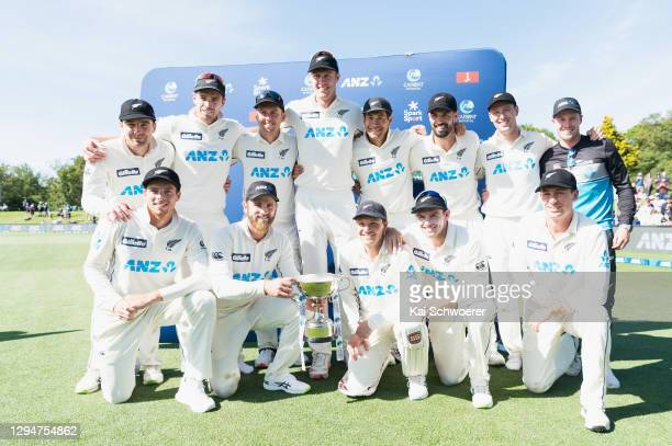 Captain Kane Williamson of New Zealand and his team mates pose with the trophy after their series win during day four of the Second Test match in the...