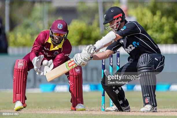 Captain Kane Williamson of New Zealand bats as his ball is fielded Wicketkeeper Shai Hope of West Indies during the first match in the One Day...