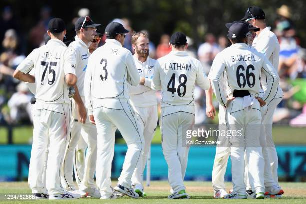Captain Kane Williamson of New Zealand is congratulated by team mates after dismissing Shaheen Shah Afridi of Pakistan during day four of the Second...