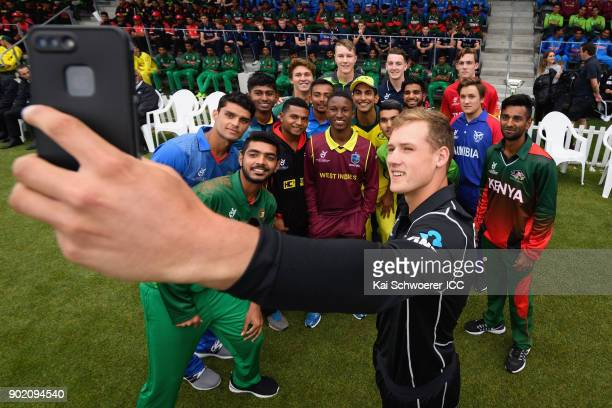 Captain Kaylum Boshier of New Zealand and his fellow team captains pose for a selfie during the ICC U19 Cricket World Cup Opening Ceremony on January...