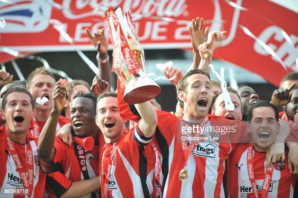 Captain Kevin O'Connor and Alan Bennett of Brentford lead the celebrations as they win the League Two Title during the Coca-Cola League Two match...