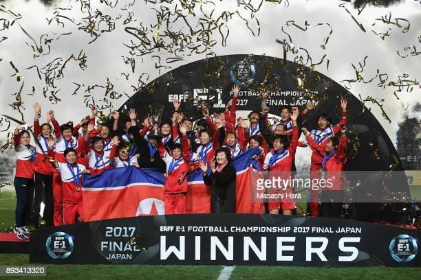 Captain Kim Nam Hui of North Korea lifts the trophy as they cerebrate the East Asian Champions at the award ceremony following their 2-0 victory the...