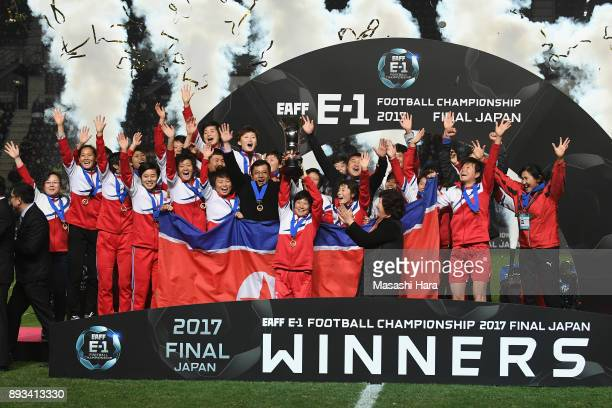 Captain Kim Nam Hui of North Korea lifts the trophy as they cerebrate the East Asian Champions at the award ceremony following their 20 victory the...