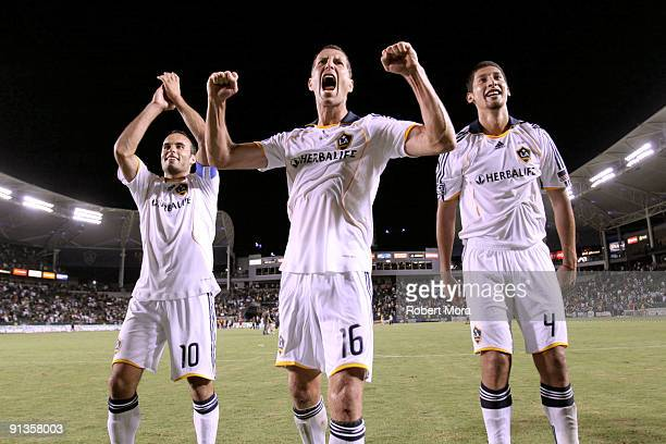 Captain Landon Donovan, Gregg Berhalter, and Omar Gonzalez of the Los Angeles Galaxy celebrate their victory over the Chicago Fire at The Home Depot...
