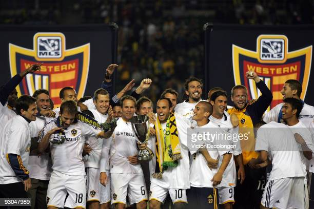 Captain Landon Donovan of the Los Angeles Galaxy and his teammates celebrate on the podium with the MLS Western Conference Trophy after defeating the...