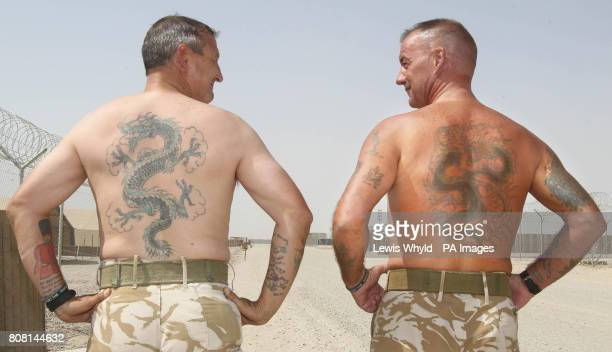 Captain Lawrence Kerr and Major Jock Dunn at Camp Bastion in Helmand Province Afghanistan show their matching dragon tattoos from their time as young...