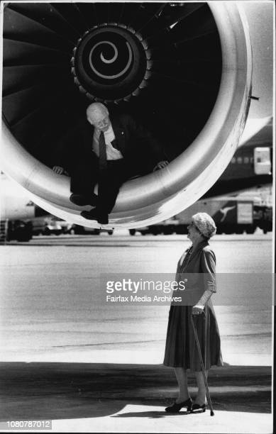 Captain Len Grey who started flying with Qantas in 1936 and is sitting in a Rolls Royce Engine of the new 747 Longreach Jumbo with the oldest...