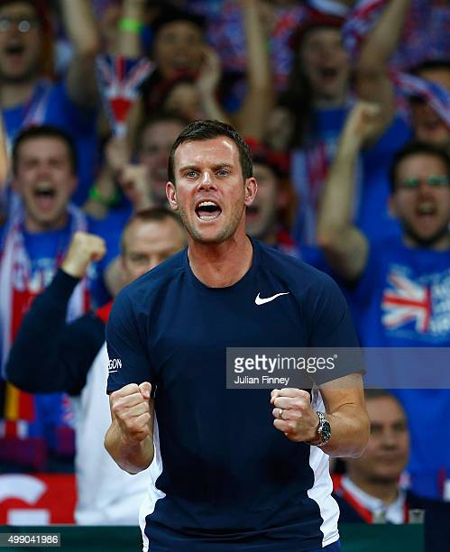 Captain Leon Smith of Great Britain celebrates a point as Jamie Murray and Andy Murray of Great Britain break back in the third set against Steve...