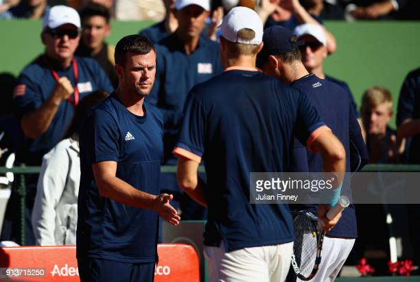 Captain Leon Smith supports Dom Inglot and Jamie Murray of Great Britain as they take on Pablo Carreno Busta and Feliciano Lopez of Spain in the...