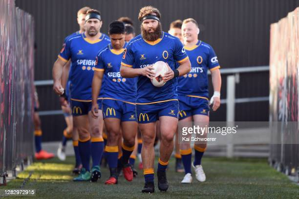 Captain Liam Coltman of Otago leads his team onto the field prior to the round 8 Mitre 10 Cup match between Canterbury and Otago at Orangetheory...