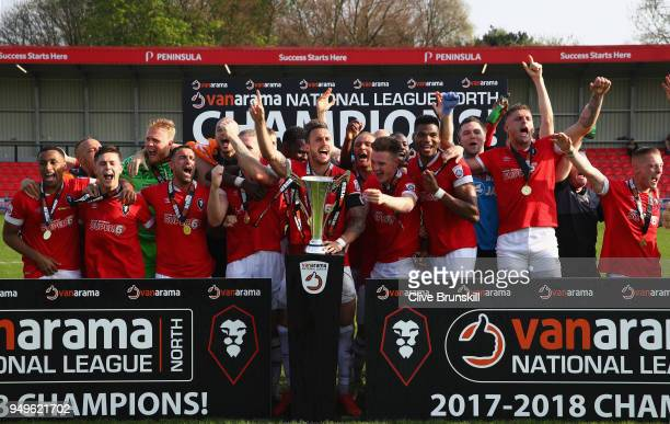 Captain Liam Hogan of Salford City holds the trophy as he celebrate winning the National League North championship with his team mates after their...