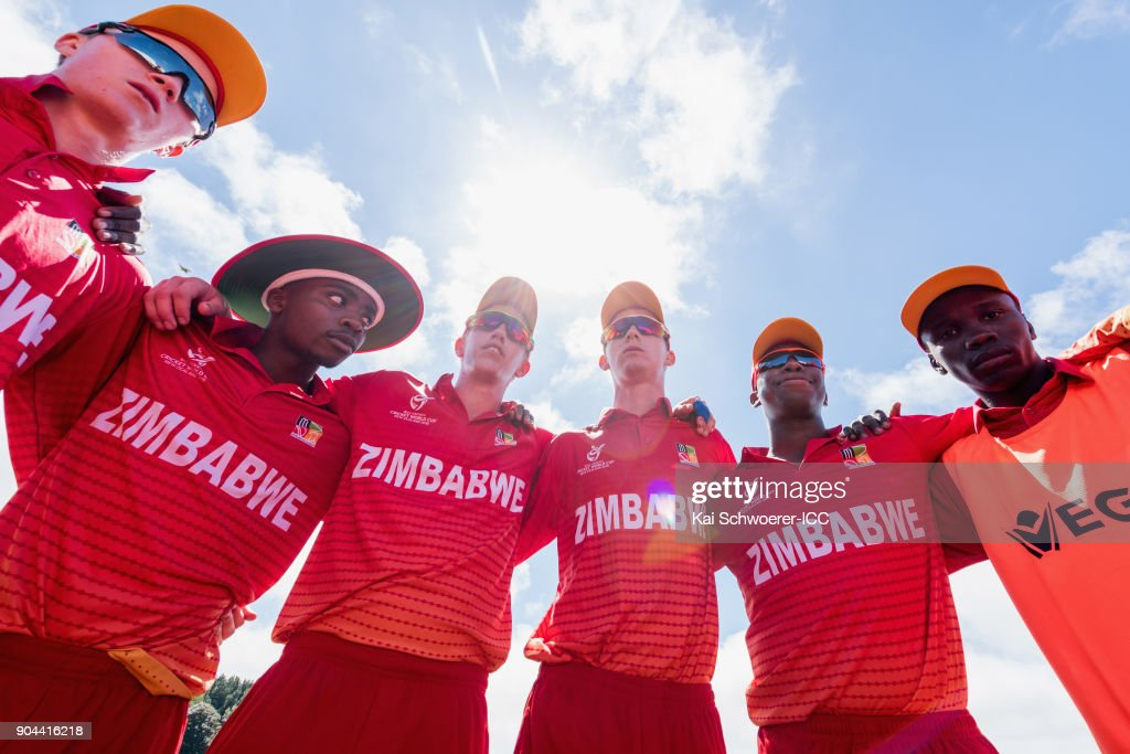 Captain Liam Roche of Zimbabwe (C) speaks to his team mates during the ICC U19 Cricket World Cup match between Zimbabwe and Papua New Guinea at Lincoln Green on January 13, 2018 in Christchurch, New Zealand.