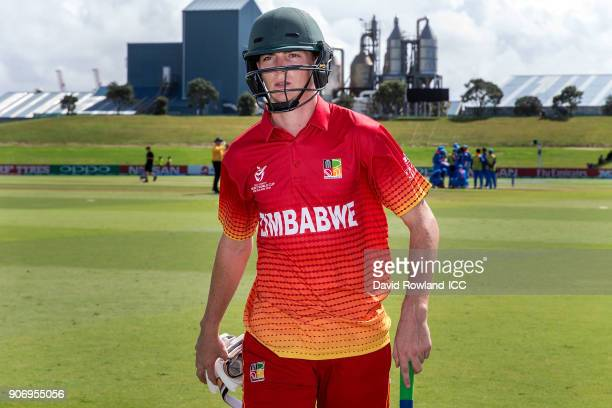 Captain Liam Roche of Zimbabwe walks back to the dressing room having been bowled out by Anukul Roy of India for 31 runs during the ICC U19 Cricket...