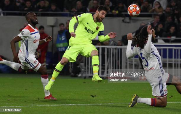 Captain Lionel Messi of FC Barcelona in action with Tanguy Ndombele and Jason Denayer of Olympique Lyonnays during the UEFA Champions League, Round...