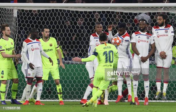 Captain Lionel Messi of FC Barcelona shoot a free kick during the UEFA Champions League Round of 16 First Leg match between Olympique Lyonnais and FC...