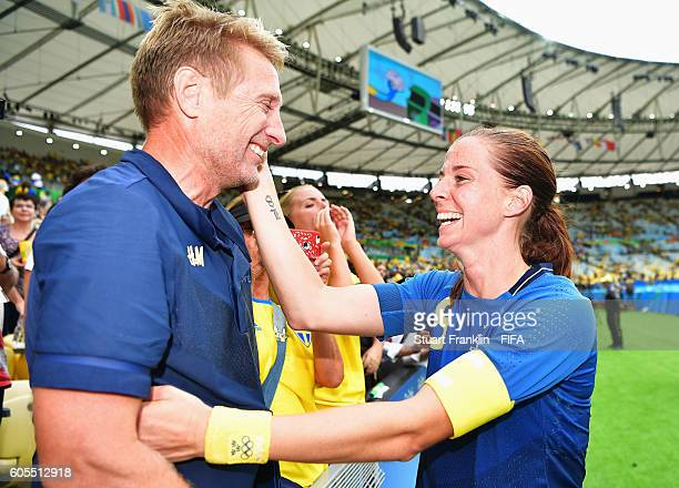 Captain Lotta Schelin of Sweden celebrates with her partner after the Olympic Womens Semi Final Football match between Brazil and Sweden at Maracana...