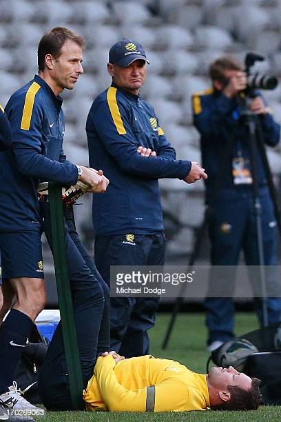 Captain Lucas Neill stretches his legs during an Australian Socceroos training session at Etihad Stadium on June 10 2013 in Melbourne Australia