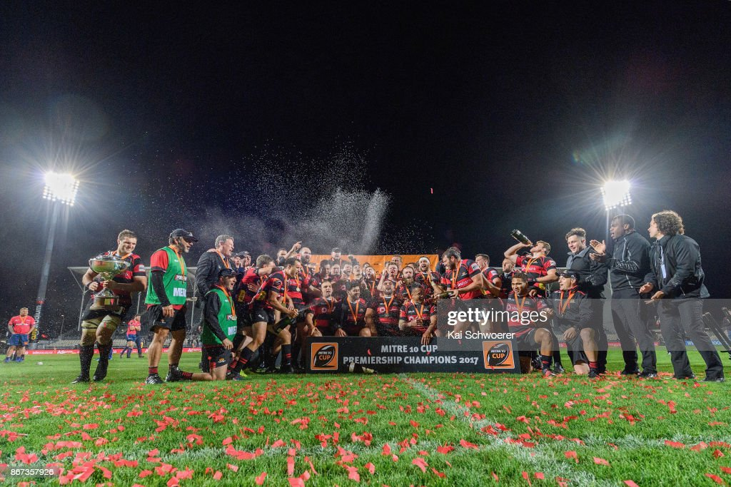 Captain Luke Whitelock of Canterbury (L) and his team mates celebrate with the Rugby Cup after their win in the Mitre 10 Cup Premiership Final match between Canterbury and Tasman at AMI Stadium on October 28, 2017 in Christchurch, New Zealand.