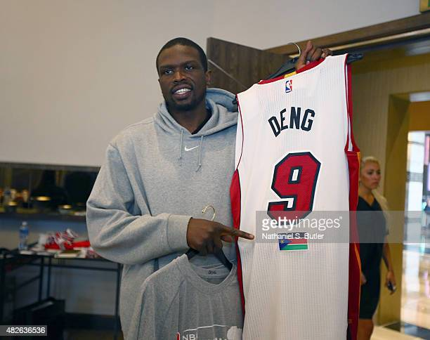 Captain Luol Deng of Team Africa smiles while holding his jersey prior to the NBA Africa Game 2015 as part of Basketball Without Borders on August 1,...