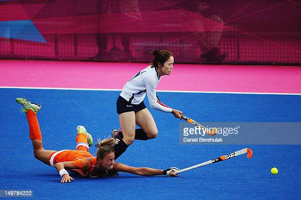 Captain Maartje Paumen of the Netherlands challenges Kim Jong Hee of South Korea during the Women's Hockey match between the Netherlands and South...