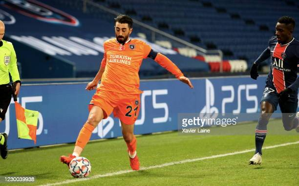 Captain Mahmut Tekdemir of Istanbul Basakehir in action with Idrissa Gueye of Paris Saint-Germain during the UEFA Champions League Group H stage...