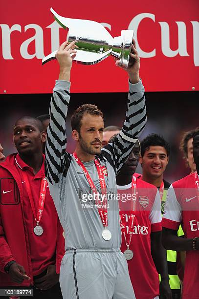 Captain Manuel Almunia of Arsenal lifts the winners' trophy after the Emirates Cup match between Arsenal and Celtic at Emirates Stadium on August 1,...