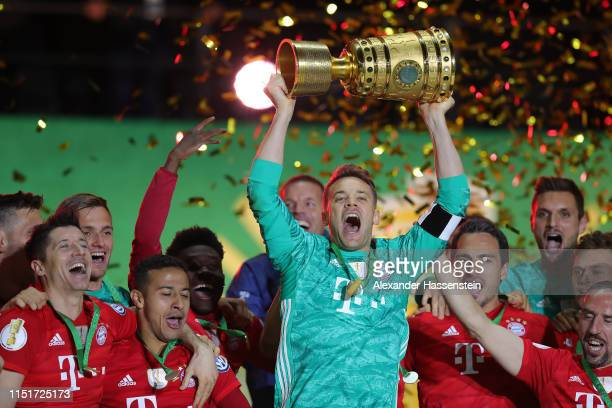 Captain Manuel Neuer of Bayern Muenchen lifts the trophy in celebration with team mates after the DFB Cup final between RB Leipzig and Bayern...