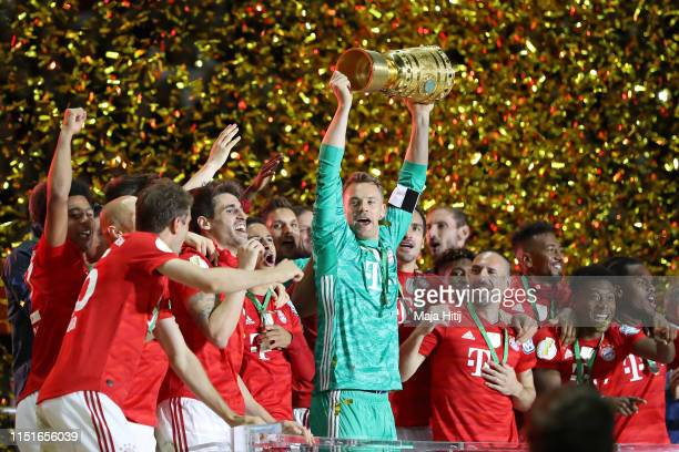 Captain Manuel Neuer of Bayern Munich lifts the trophy in celebration with team mates after the DFB Cup final between RB Leipzig and Bayern Muenchen...