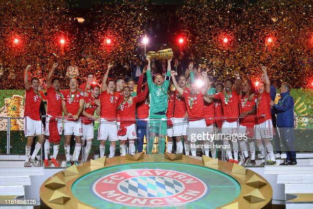 Captain Manuel Neuer of Bayern Munich lifts the trophy in celebration after the DFB Cup final between RB Leipzig and Bayern Muenchen at...