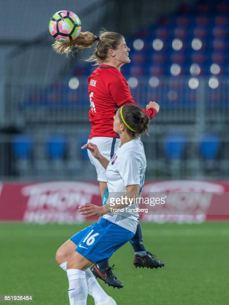 Captain Maren Mjelde of Norway Diana Bartovicova of Slovakia during the FIFA 2018 World Cup Qualifier between Norway and Slovakia at Sarpsborg...