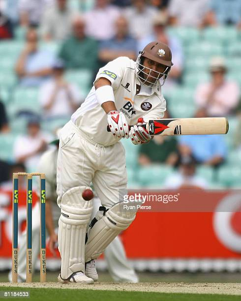 Captain Mark Butcher of Surrey plays a shot during day one of the Liverpool Victoria County Championship Division 1 match between Surrey and...