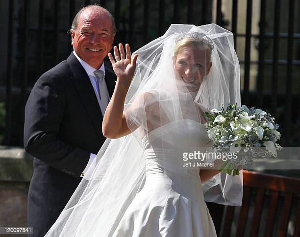 Captain Mark Phillips and Zara Phillips arrive for the Royal wedding of Zara Phillips and Mike Tindall at Canongate Kirk on July 30 2011 in Edinburgh...