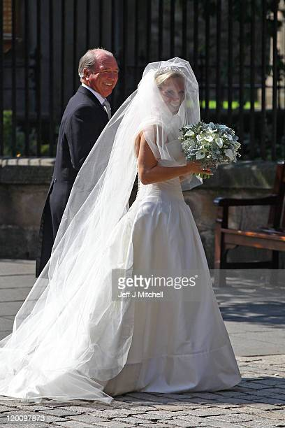 Captain Mark Phillips and Zara Phillips arrive for the Royal wedding of Zara Phillips and Mike Tindall at Canongate Kirk on July 30, 2011 in...