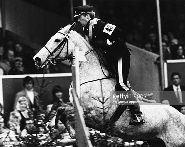 Captain Mark Phillips riding 'Favour' during the jumping section of the Badminton Horse Trials England April 11th 1976