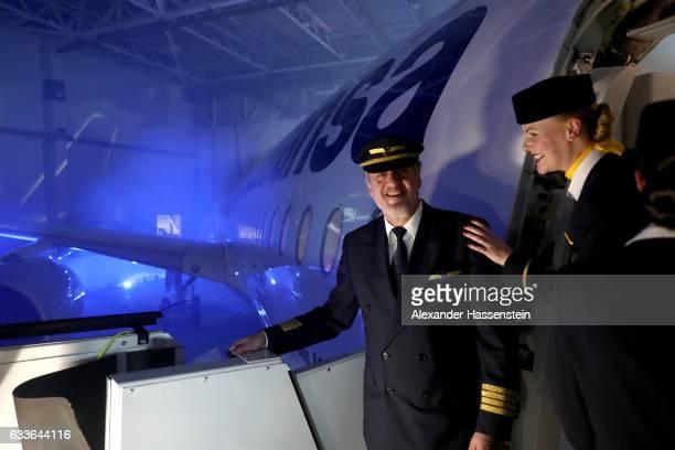 Captain Martin Hoell fleet commander of Lufthansa Hub Munich stands a the main door of Lufthansa's first Airbus A350900 passenger plane during a...