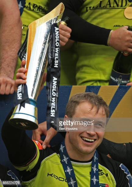 Captain Mathew Tait of Leicester Tigers lifts the trophy following his team's 1612 victory during the AngloWelsh Cup Final between Exeter Chiefs and...
