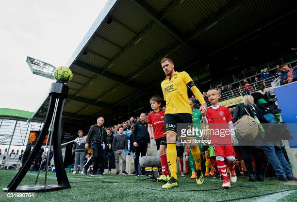 Captain Mathias Nielsen of AC Horsens leading is team on to the pitch prior to the Danish Superliga match between AC Horsens and AGF Aarhus at CASA...