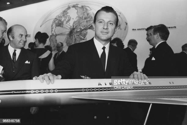 Captain Maurice Bernard of Air France pictured with a model of the Anglo French supersonic passenger aircraft Concorde at an airline industry...