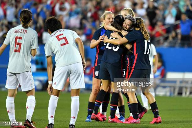 Captain Megan Rapinoe of the United States and Tobin Heath hug Christen Press after her goal during the first half of the SheBelieves Cup match...