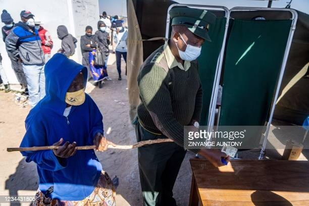 Captain Memory Mapudzi assist an elderly partially blind woman to get a COVID-19 jab during the Defence Forces community outreach vaccination program...