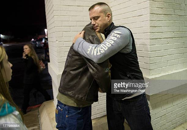 Captain Michael Bolton employment coordinator for the Oklahoma National Guard 45th Infantry Brigade Employment Coordination Program hugs Staff...