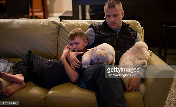 Captain Michael Bolton employment coordinator for the Oklahoma National Guard's Employment Coordination Program cuddles with his son William Wil...