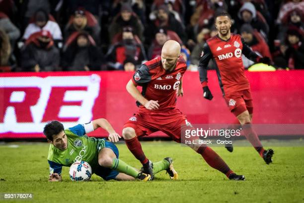 Captain Michael Bradley of Toronto FC and Captain Nicolas Lodeiro of Seattle Sounders battle for the ball during the 2017 Audi MLS Championship Cup...
