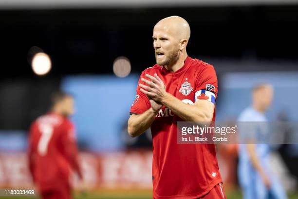 Captain Michael Bradley of Toronto FC claps as he charges up his team during the 2nd half of the 2019 MLS Cup Major League Soccer Eastern Conference...