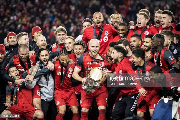 Captain Michael Bradley of Toronto FC holds the MLS Championship Cup celebrates with teammates after the 2017 Audi MLS Championship Cup match between...